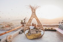 Romantic Couple Watching A Sunrise In A Basquet In Cappadocia