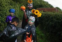 Four Children In Halloween Cos...