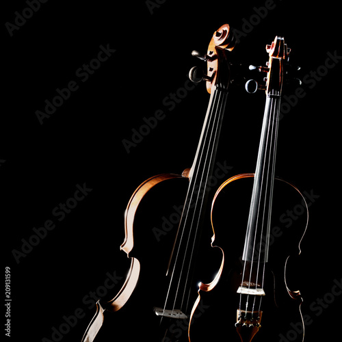 Photo  Violin isolated. Duet of two violins