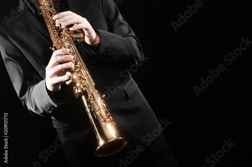 Foto auf Gartenposter Musik Saxophone player. Saxophonist playing soprano sax jazz music instrument.