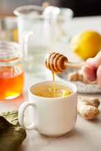 Tasty Tea With Honey, Lemon And Ginger In White Cup.