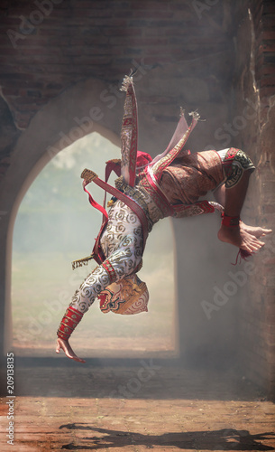 Hanuman (monkey god) somersaults in Khon or Traditional Thai Pantomime as a cultural dancing arts performance in masks dressed based on the characters in Ramakien or Ramayana Literature.