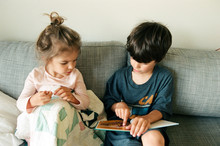 Older Brother Reads To Sister ...