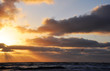 Kitesurfing against the sunset on the North sea