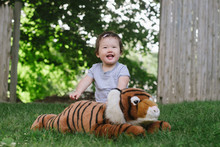 Happy Baby With Tiger Stuffed ...