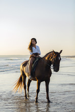 Young Woman Riding A Horse At ...