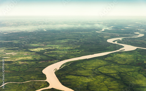 Valokuva  Landscape aerial view of colorful Amazon rivers, forest with trees, jungle, and