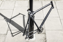 Bicycle Frame Locked To A Post