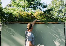 Sukkot: Man Covers Roof Of Sukkah With Branches