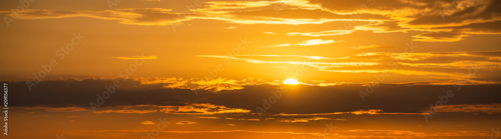 Fototapeta Golden color of dramatic clouds and sky on sunset