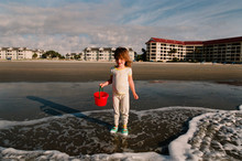 Little Girl Collects Shells In...