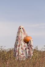 Cute Ghost Holding Pumpkin