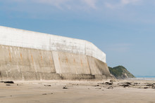 High Concrete Wall At Seaside ...