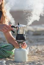 Caucasian Woman Boiling Coffee...