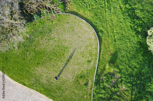 aerial shot of a person standing on lawn