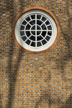 Vintage Round Window On A Brick Wall