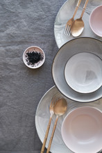 Dinner Place Setting On Grey Linen Tablecloth