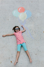 Young Girl With Sunglasses Hol...