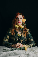 Portrait Of A Cool Ginger Woman With Yellow Roses Wearing A Floral Suit
