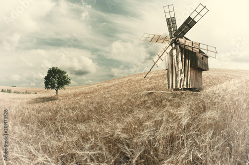 Vintage Windmill on Wheat Field