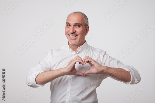 old european man making out of hands heart Poster