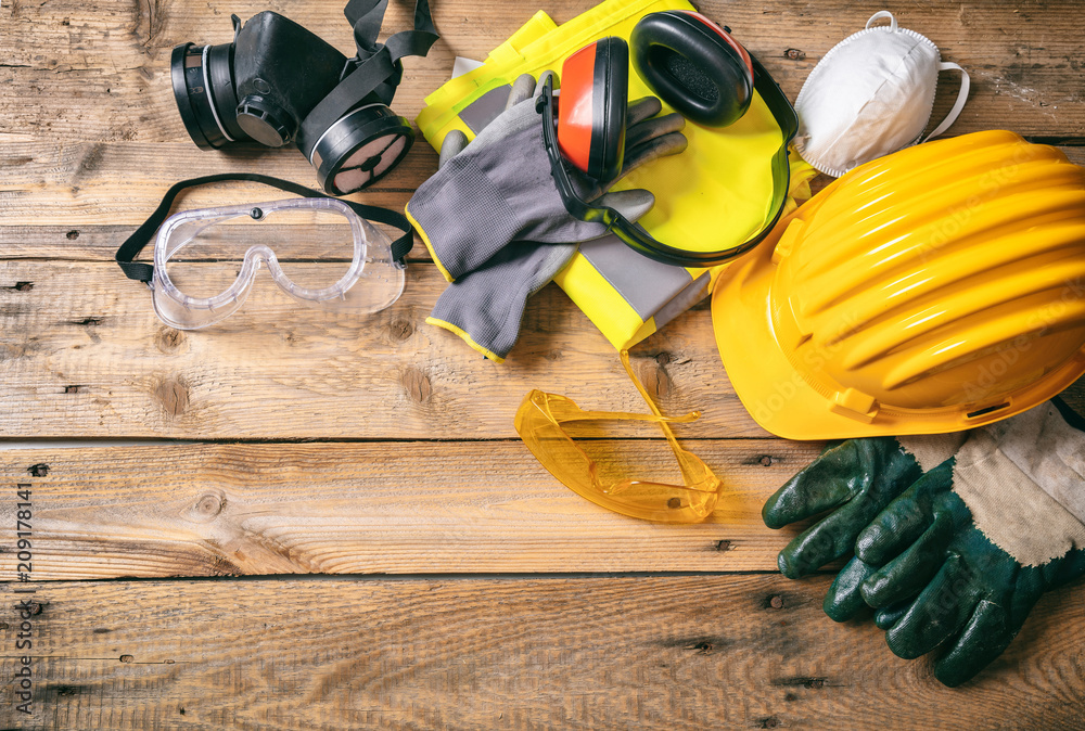 Fototapety, obrazy: Construction safety. Protective hard hat, headphones, gloves and glasses on wooden background, copy space, top view