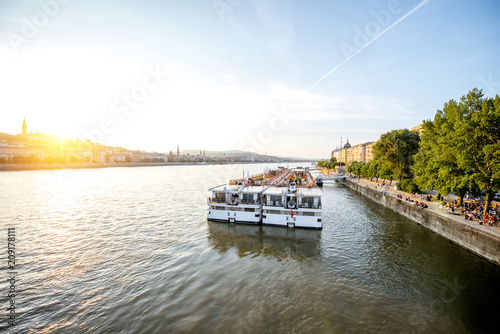 Fotobehang Centraal Europa Landscape view on Danube river with tourist ship during the sunset in Budapest city, Hungary