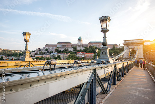 Fotobehang Centraal Europa Beautiful cityscape view on the famous Chain bridge on Danube river during the sunset in Budapest city, Hungary