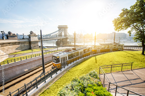 Fotobehang Centraal Europa Cityscape view on the tram and famous Chain bridge on the background during the morning light in Budapest city, Hungary