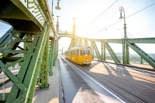 Fotobehang Centraal Europa View on the famous Liberty bridge with old yellow tram during the morning light in Budapest, Hungary