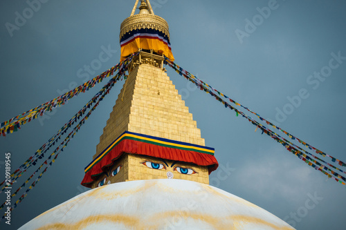 Boudhanath stupa in Kathmandu, Nepal. Stormy clouds in the background.