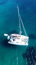 Aerial Drone Bird's Eye View Photo From Luxury Catamaran Docked At Tropical Deep Waters