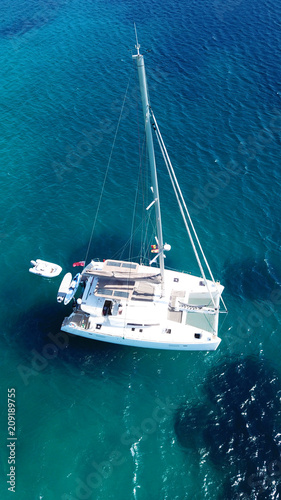 Fotografie, Obraz Aerial drone bird's eye view photo from luxury Catamaran docked at tropical deep