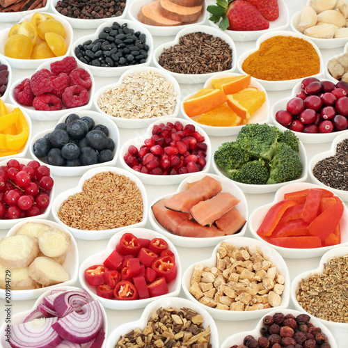 Poster Assortiment Healthy food nutrition for good health with fresh fruit, vegetables, fish, cereals, seeds, herbs and herbal medicine. Super food concept with foods high in omega 3 protein, antioxidants & fibre.