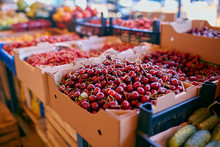 Sweet Cherry On A Farm Market In The City. Fruits And Vegetables At A Farmers Market. Cherries In Boxes And Trays