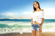 slim young woman on beach and free space for your text.