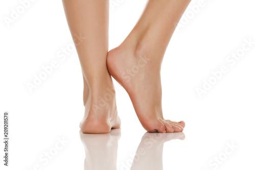 Fotomural beautifully groomed bare feet on white background