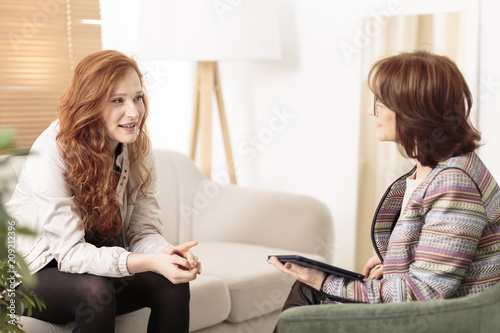 Friendly therapist supporting red-haired woman
