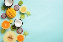 Exotic Fruits On Pastel Blue Background - Papaya, Mango, Pineapple, Banana, Carambola, Dragon Fruit, Kiwi, Lemon, Orange, Melon, Coconut, Lime. Top View.