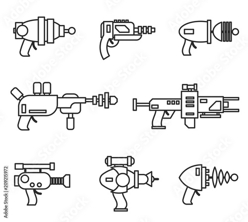 Photo Set of futuristic space weapons , ray guns or laser blasters in cartoon retro style