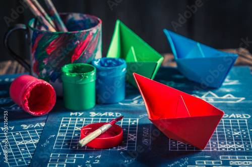 Carta da parati Closeup of battleship paper game with coloured ships