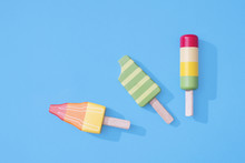 Ice Cream Popsicles Lollipops On Pastel Blue Background For Summer.  Wooden Ice Cream Lolly Toys
