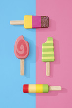 Ice Cream Popsicles Lollipops On Blue And Pink Pastel Background For Summer.  Wooden Ice Cream Lollies Toys
