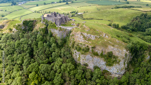 Canvas Print Aerial view of a ruined castle overlooking rural farmland in Wales (Britain)