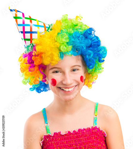 Fotografía Funny little girl in clown wig with red spots on her cheeks isolated on white ba