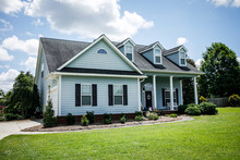 Blue Traditional Siding House Home In Suburbs Front Facing With Curb Appeal