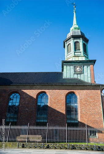 low angle view of beautiful church with clock and spire, copenhagen, denmark Poster