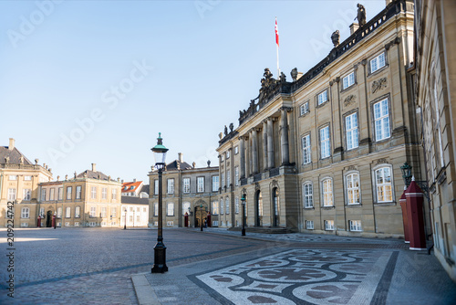 empty Amalienborg Square with historical buildings, pavement and street lamps in Poster