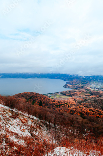 Keuken foto achterwand Turkoois Hokkaido Usuzan mountain forest and lake Toya in urly winter with autumn foliage yellow tree, aerial view