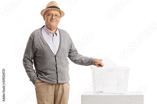 Poster  Elderly man casting his vote into a ballot box